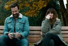 Jason Sudeikis and Anne Hathway in Colossal - a far darker movie than the trailer implies. Photo / Neon via AP