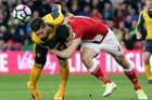 Arsenal's Olivier Giroud (left) and Boro's Daniel Ayala battle for possession. Photo / AP