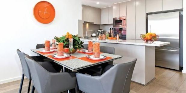 The open plan dining area. All furniture and appliances are included. Photo / Supplied