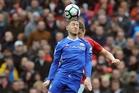 Manchester United's Ander Herrera (back) kept a tight rein on Chelsea's Eden Hazard yesterday. Photo / AP