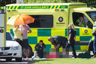 Ambulance staff attend the injured cyclist on Te Ngae Rd.  Photo/Ben Fraser