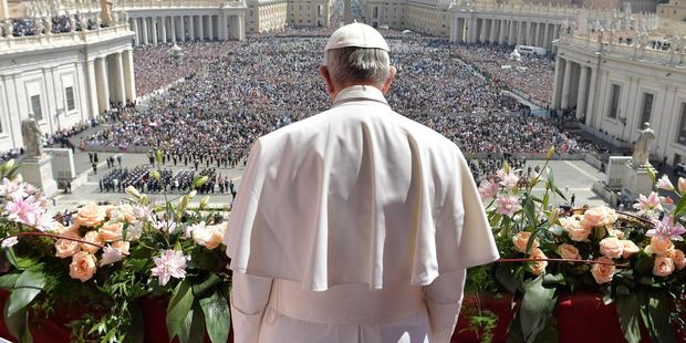 Pope Francis addresses the crowd prior to delivering his Urbi et Orbi (to the city and to the world) message from the main balcony of St Peter's Basilica, at the Vatican. Photo / AP