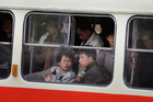 Commuters ride on an electric trolley in Pyongyang, North Korea. Photo / AP