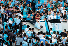 Emanuel Balbo is thrown from the stands by other fans during a match between Belgrano and Talleres, in Cordoba, Argentina. Photo / AP