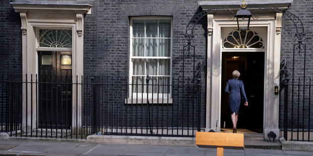 Loading Britain's Prime Minister Theresa May walks back into her official residence of 10 Downing Street in London, after speaking to the media to announce the election. Photo / AP