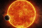 This planet is located in the liquid water habitable zone surrounding its host star, a small, faint red star named LHS 1140. Photo / AP