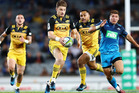 Beauden Barrett of the Hurricanes makes a break during the round eight Super Rugby match. Photo / Getty Images.