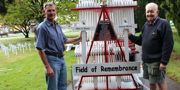 Allan Toxward (left) and John Ross at the Dannevirke Domain with the specially designed trailer to carry the white crosses of remembrance.