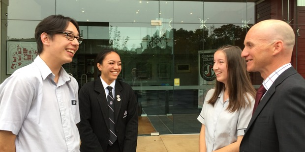 Glenfield College students Filip Ograbek (left), Anzia Singe and Nicola Moody-Turnwald talk with principal C J Healey