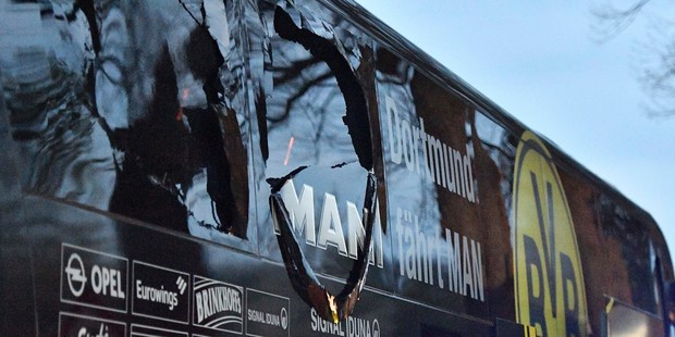 A window of Dortmund's team bus is damaged after the explosion. Photo / AP