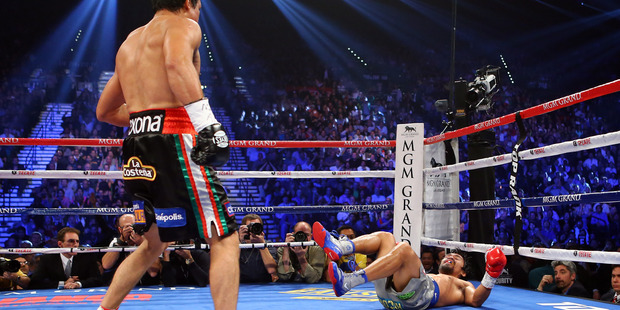 Juan Manuel Marquez knocks down Manny Pacquiao in the third round during their welterweight bout at the MGM Grand Garden Arena. Photo/Getty Images