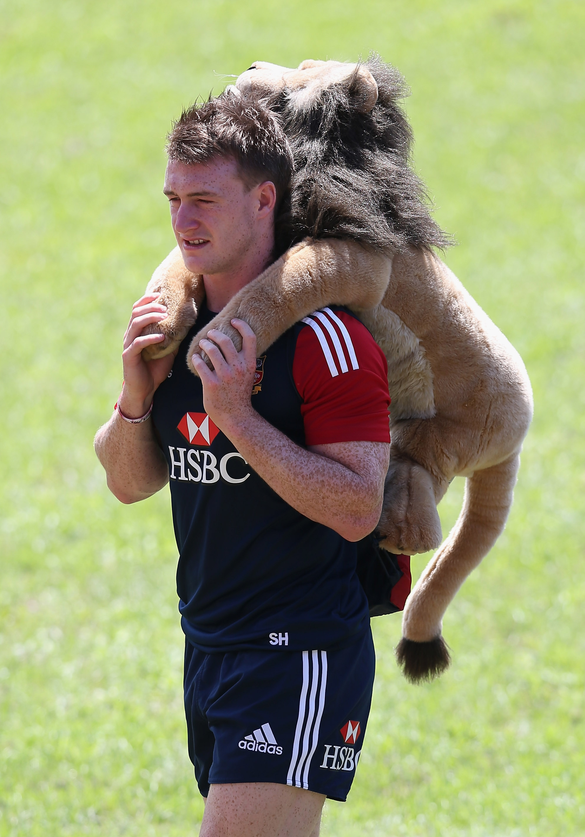 As the youngest player in the squad, Scottish fullback Stuart Hogg was given the duty of looking after the Lions mascot during the 2013 Lions tour to Australia. Photo / Getty Images.