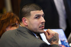Former New England Patriots tight-end Aaron Hernandez sits at the defence table during his double murder trial. Photo/Getty Images