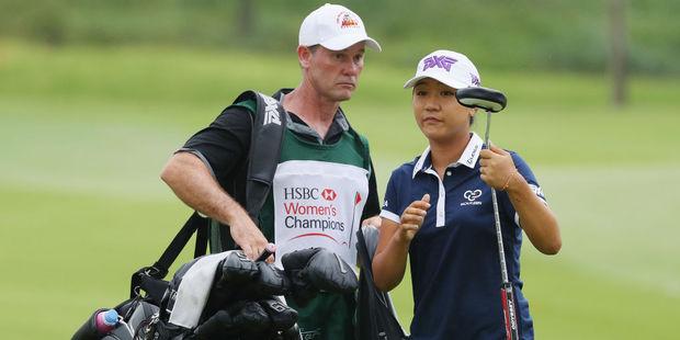 Lydia Ko of New Zealand alongside caddie Gary Matthews. Photo / Getty