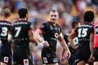 Kieran Foran of the Warriors celebrates with teammates after scoring a try. Photo / Getty