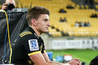 Beauden Barrett watches on after being yellow carded against the Waratahs at Westpac Stadium in Wellington earlier this month. Photo / Getty Images.