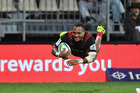 Hat-trick hero Manasa Mataele dives over to score for the Crusaders during their 50-3 win over the Sunwolves at AMI Stadium in Christchurch on Friday. Photo / Getty Images.