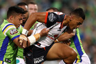 Ken Maumalo of the Warriors is tackled against the Raiders. Photo / Getty Images
