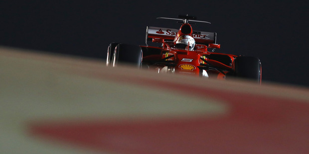 Sebastian Vettel of Germany driving the Scuderia Ferrari SF70H during qualifying for the Bahrain Formula One Grand Prix, Photo/Getty Images