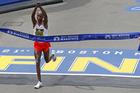 Mens winner Geoffrey Kirui crosses the finish line of the 121st Boston Marathon. Photo/Getty Images