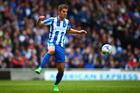 Uwe Hunemeier of Brighton & Hove Albion in action during the Sky Bet Championship match against Wigan Athletic. Photo/Getty Images