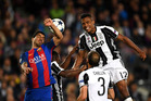 Barcelona's Luis Suarez and Juventus' Alex Sandro contest for the ball during their side's Champions League semi-final second leg clash at the Nou Camp in Barcelona this morning. Photo / Getty Images.