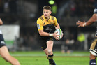 Beauden Barrett in action for the Hurricanes during their 56-21 victory over the Brumbies at McLean Park in Napier last night. Photo / Getty Images.