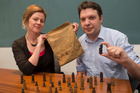 Whitireia lecturer Alice Moore and reporter Jamie Morton, with chess pieces carved by their great grandfather Harry Bourke in Belgium, 1917. Photo / Mark Mitchell