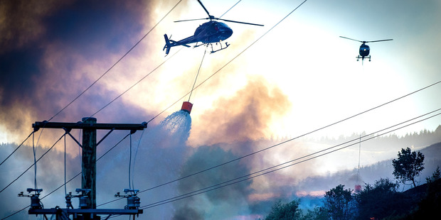 Loading Fire fighters and helicopters fighting the blaze on the Port Hills Christchurch around Osterholts Road, Tai Tapu. Photo / Christchurch Star