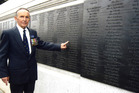 Soldier Ian Walker pointing to his name at the Battle of Britain monument. Photo / Supplied