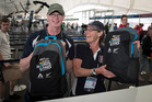 2017 World Masters games competitors from the English Navy team Gary Thomas and Lou Mittins collect their bags at athlete registration at the Cloud on Queens Wharf. Photo / Greg Bowker