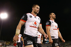 Kieran Foran and Simon Mannering of the Warriors look dejected after defeat in the NRL Rugby League match between Canberra Raiders and Vodafone Warriors. Photo / Getty Images.