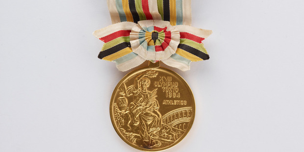 Peter Snell's gold medal from the Tokyo Olympics, donated to Te Papa.  Photo / Te Papa Tongarewa