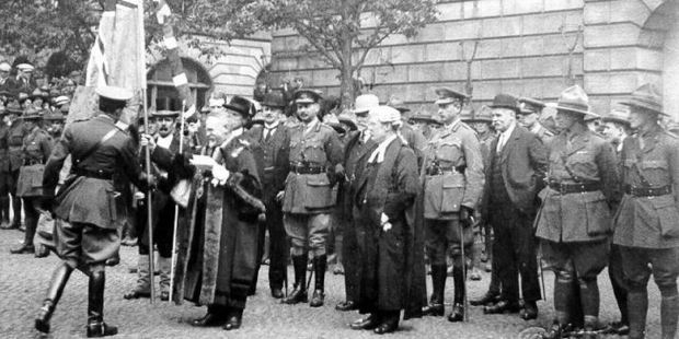 Photos from the 1919 ceremony of the Mayor of Stafford presenting NZ troops with a Union Jack and the New Zealand Ensign