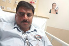 Taxi driver Vineet Mahajan, 48, in Middlemore Hospital after yesterday's attack. Photo / Supplied