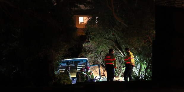 Emergency services attend the scene of a incident where a bus lost its brakes on a steep driveway and crashed into two parked cars in Coronia Crescent in Lynfield. Photo / Peter Meecham