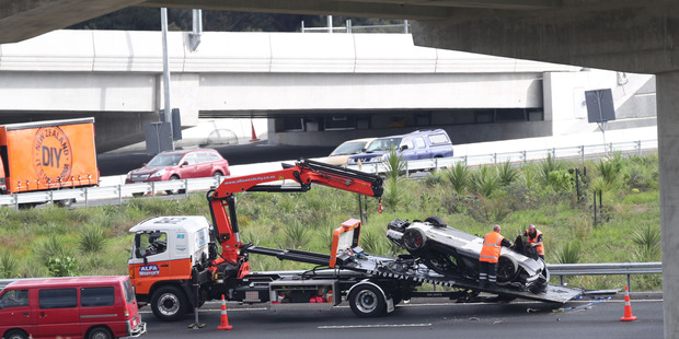 Loading A McLaren supercar is loaded on to a recovery truck after an accident on the Great North Rd on-ramp on to the Northwestern Motorway in Auckland. Photo / Peter Meecham