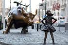 Fearless Girl faces down Charging Bull at  New York's financial hub. Photo / AP
