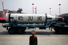 A submarine missile is paraded across the Kim Il Sung Square during a military parade. Photo /AP