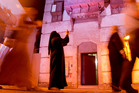 In this April 6,  file photo, a visitor takes pictures at the historical Jiddah old city, Saudi Arabia. Photo / AP