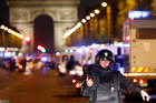 A police officer stands guard after the Champs Elysees attack in Paris early this morning. Photo / AP