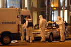 Forensic experts collect evidences from the car belonging to an attacker who killed a police officer on the Champs Elysees avenue in Paris, France. Photo / AP