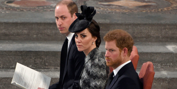 Prince Harry, right, Kate, the Duchess of Cambridge, center and Prince William. Photo / AP