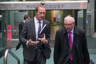 Labour Party leader Andrew Little leaving the Wellington High Court with his lawyer, John Tizard. Photo / Mark Mitchell