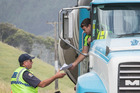 Police Commercial Vehicle Investigation Unit staff check a truck at a weigh station near Huntly. Photo / Greg Bowker
