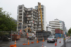 A building in Molesworth St, Wellington is demolished after the November 14 earthquake. Photo /  Mark Mitchell