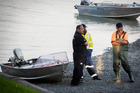 An aluminium boat is recovered at a boat ramp in Weymouth with the coastguard and police at the scene. Photo / Jason Oxenham