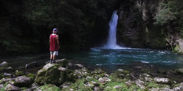 Ryan Lucas stares at the Tauranga Taupo waterfall that nearly took his life in February of 2017. Photo / Nick Reed