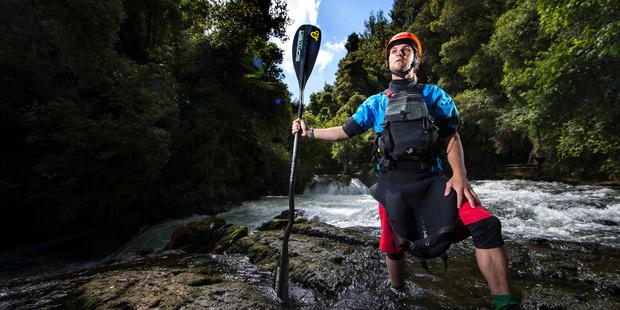 Loading Top New Zealand extreme whitewater kayaker, Ryan Lucas at the powerhouse rapids on the Kaituna River, Rotorua. Photo / Nick Reed