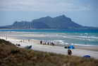 Three men got into trouble in waters off a Ruakaka beach on Friday, including a crabber who nearly drowned in 3m swells. Photo / File